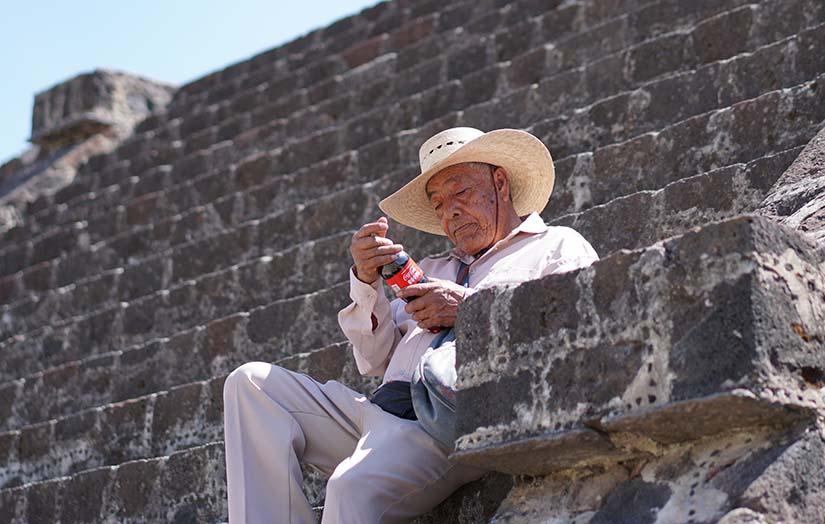 Man Looking At Coke